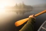 Wooden paddle canoeing lake foggymorning